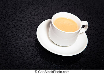 cup coffee on the black background
