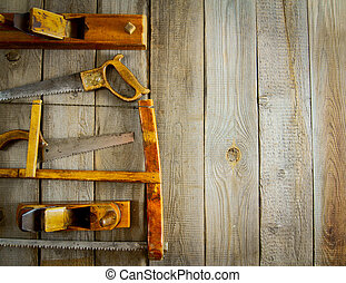 Various tools on a wooden background - Old working tools...