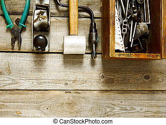 Many working tools on a wooden background. - Old working...