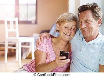 Senior couple - Happy senior couple taking selfie in their...