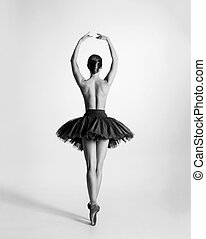 Black and white trace of young beautiful topless ballet dancer isolated over white background