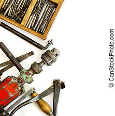 Vintage working tools ( drill and more) on white background....
