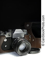 Old Retro Camera - Old Retro camera ,leather cap and old...