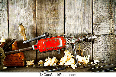 Old tools (Plane and drill) on a wooden shelf. - Old working...