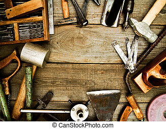 Vintage working tools on wooden background. - Old working...