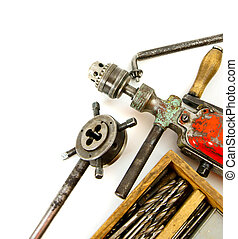 Vintage working tools drill and more on white background -...