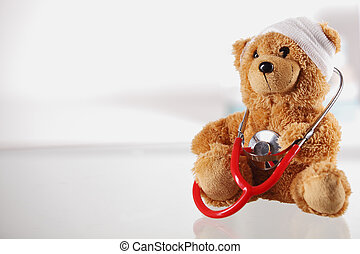 Bandaged Teddy Bear on the Table with Stethoscope - Close up...