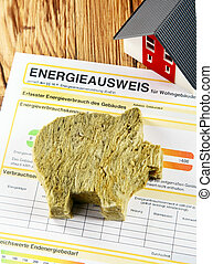 Energy saving concept with a piggy cut out of rockwool...