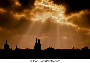 Dramatic dark sky and silhouette of ancient church -...