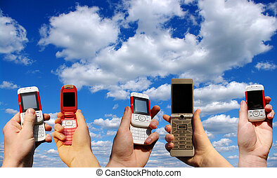 mobile phones  - Many hands holding mobile phones