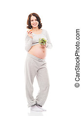Young, healthy and happy pregnant woman isolated on white