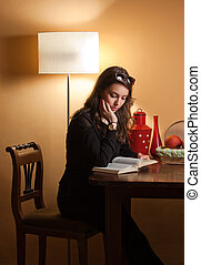 Immersed in reading - Portrait of young brunette beauty...