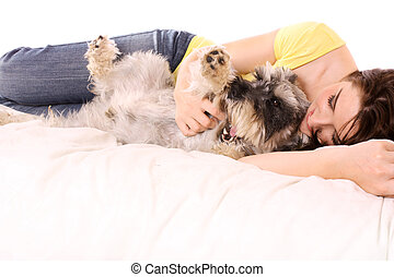 Girl with her adorable Schnauzer - A pretty young woman in...