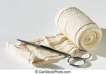 bandage and scissors - medical scissors and bandages with...