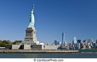 The Statue of Liberty and Manhattan - The Statue of Liberty...
