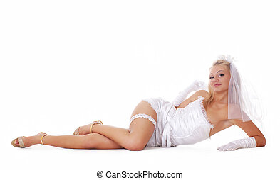Young sexy bride in vulgar pose isolated on white