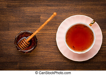 The top view on a cup of tea with honey. healty food