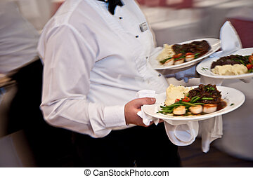 Serving - Plates of foods were being serviced at a party