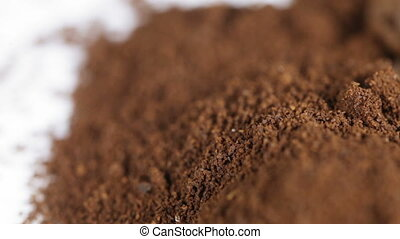 Ground coffee grains - Shooting ground coffee and beans on...