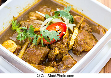 Indian curry lamb rogan josh in a white bowl