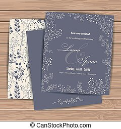 Wedding invitation cards with floral elements on wood plank...