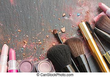 brushes on eye shadows palette - set of brushes, lipsticks...