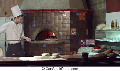 Pizza Done to a Turn - Static camera shot of restaurant cook...