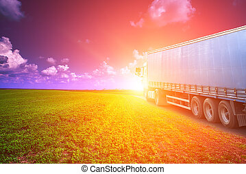 a truck drives through the field