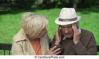 Health Concerns - Close up of senior woman reassuring man...