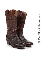 Brown leather cowboy boots on white