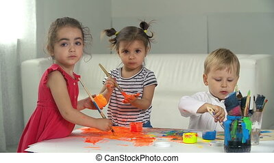 Artistic Playroom - Three kids drawing and smudging gouache...
