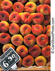 Flat peaches, called paraguayas in a market stall