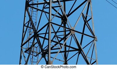 high voltage - electricity pylon camera motion against blue...