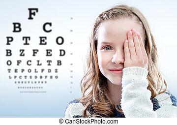 Child reviewing eyesight - Close up portrait of girl...