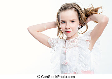 Attractive girl in communion dress. - Close up beauty...