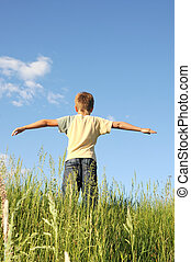 Man with his arms wide open his arms - freedom concept