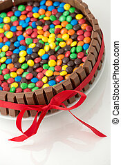 Chocolate candy cake attached with a ribbon