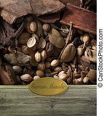 Garam Masala labeled - Garam masala spices frame in wood...