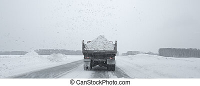 Truck KAMAZ carrying the snow