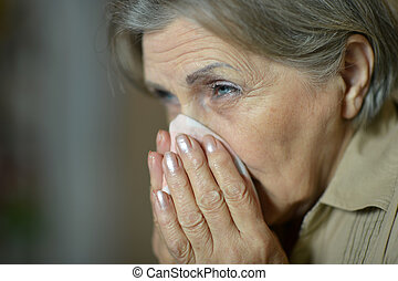 woman fells ill  - Mature woman fells ill at home closeup