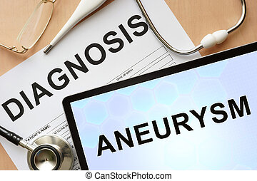 Aneurysm - Tablet with diagnosis aneurysm and stethoscope....