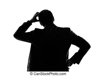rear view back thinking business man silhouette - one...