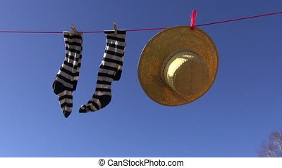 socks and summer straw hat - laundry line with woman socks...