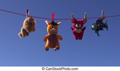 soft animal toys on clothes-line - colorful beautiful soft...