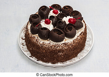 Chocolate cake - Cake decorated on top chocolate , whipped...