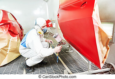 car painting technology - auto mechanic worker painting a...