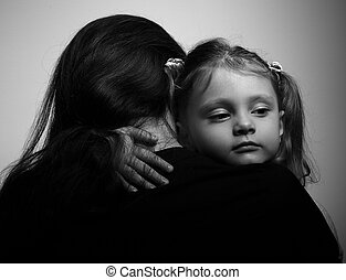 Family lifestyle. Daughter hugging her mother and looking...