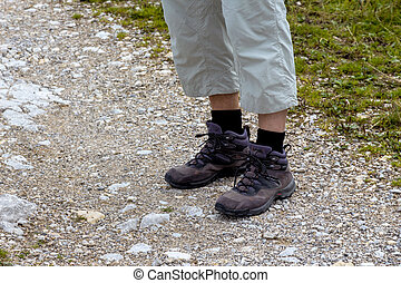 man in hiking boots - woman in hiking boots, a symbol of...