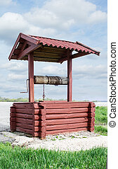 Water well over blue sky background
