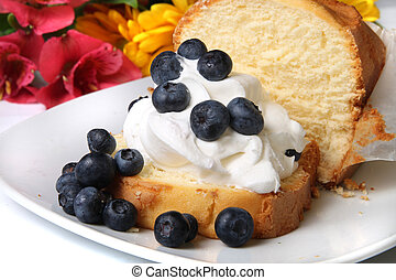 Blueberry shortcake - Slice of pound cake with whipped cream...